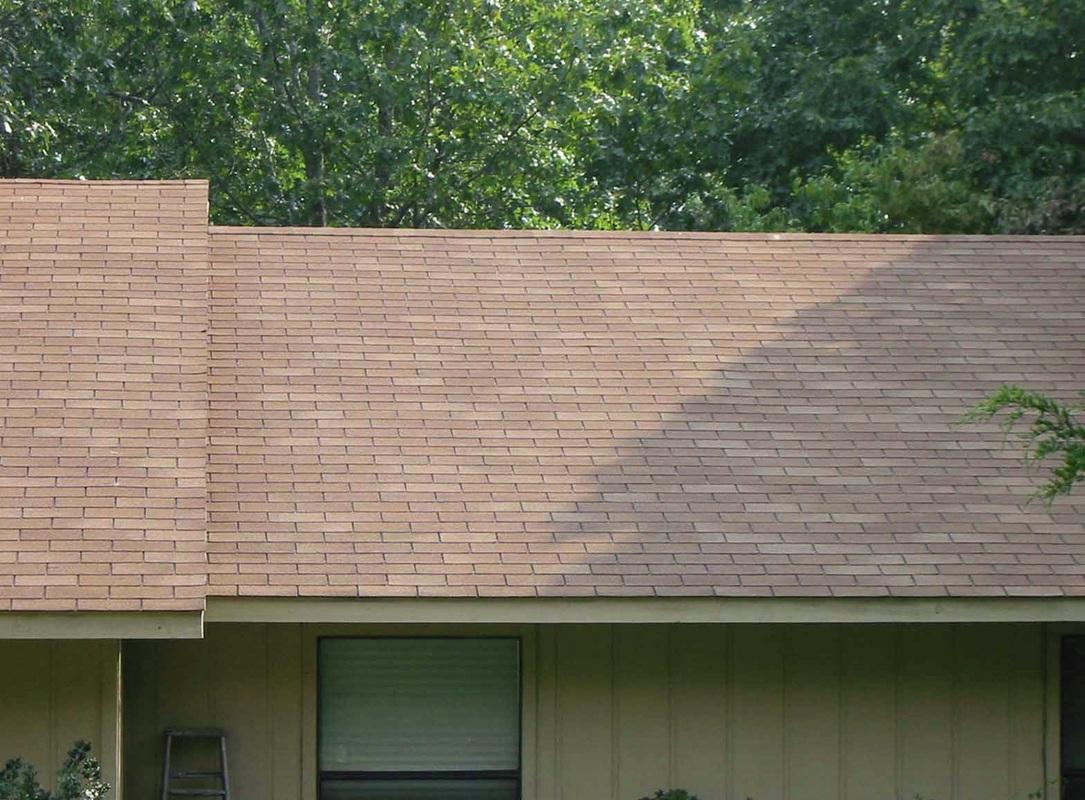 Photos Of Dark Roof Algae Streaks Being Cleaned From